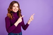 canvas print picture - Portrait of her she nice attractive confident cheerful cheery positive wavy-haired girl pointing two forefingers ad advert copy space isolated over pastel purple violet lilac background