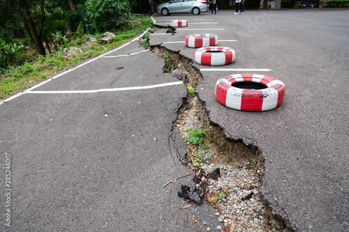 Fotografija The road in the outdoor public parking lot collapsed,road collapses,cracked asph