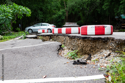 The road in the outdoor public parking lot collapsed,road collapses,cracked asph Fototapeta