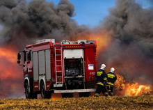 Fire Truck And Firefighters Du...