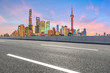 Shanghai skyline and modern buildings with empty asphalt highway at sunrise,China