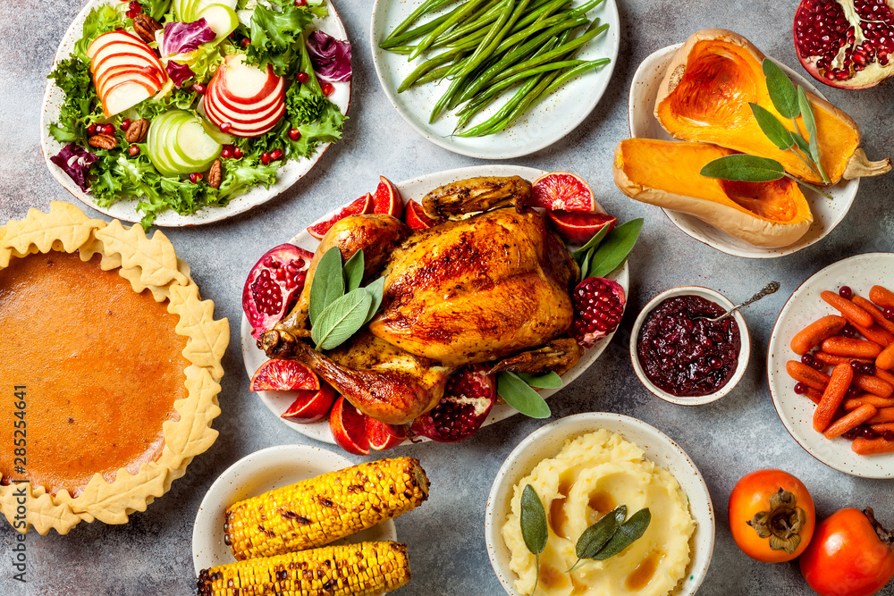 Fototapety, obrazy: Thanksgiving dinner table with roasted whole chicken or turkey, green beans, mashed potatoes, cranberry sauce and grilled autumn vegetables. Top view, overhead.