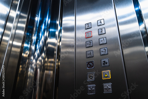 Fotografie, Tablou Elevator Buttons for Disabled Blind People with Braille Language Signs on Panel
