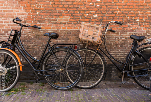 Foto auf Leinwand Fahrrad Vintage bicycle on the street, Holland, Europe