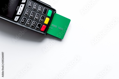 Fotografie, Obraz  payment terminal with card on white background top view