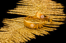 Two Wadding Gold And Diamond Ring On Gold Feather
