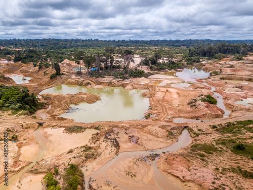 Vászonkép Aerial view of deforested area of the Amazon rainforest caused by illegal mining activities in Brazil
