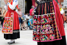 Woman Dancing And Wearing One Of The Traditional Folk Costume From Portugal