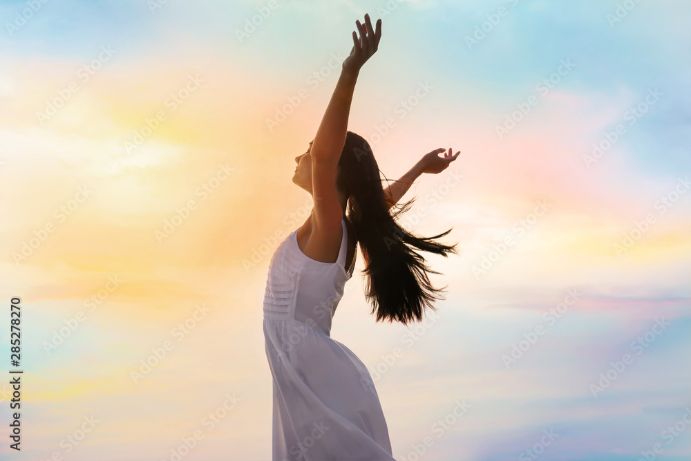 Fototapeta Young woman enjoying summer day against sky. Freedom of zen