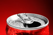 Wet open can on red background, closeup