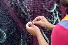 Fisherman Repairing Fishing Nets 2