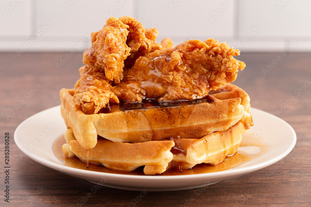 Fototapety, obrazy: Pile of Chicken and Waffles on a Rustic Wooden Counter