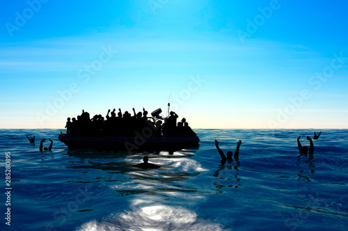 Fotografie, Obraz Refugees on a big rubber boat in the middle of the sea that require help