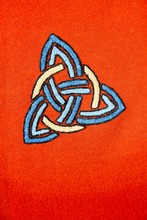 Interlaced Triquetra Symbol On A Red Blanket