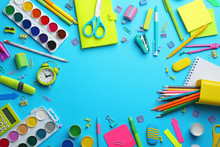 Frame Made With Colorful School Stationery On Light Blue Background, Flat Lay. Space For Text