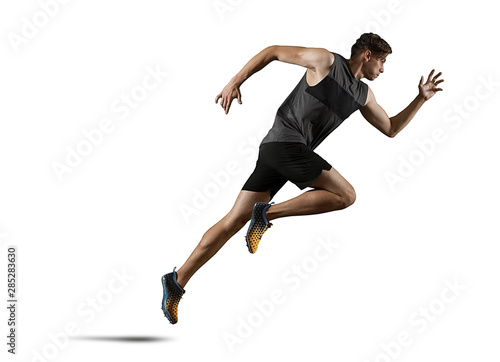 Foto Man running. Isolated on white