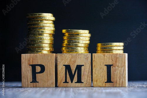 Photo Text PMI on wood cube decoorate with coins stack with black background , economic on down trend
