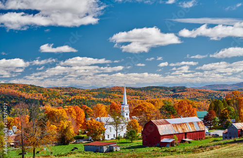 Cadres-photo bureau Bleu jean Congregational Church and farm with red barn at sunny autumn day in Peacham, Vermont, USA