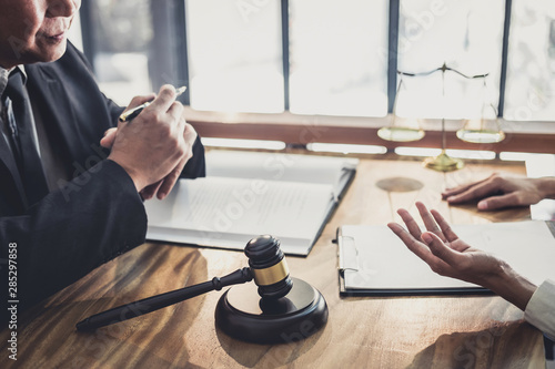 Fotografija Consultation and conference of professional businesswoman and Male lawyers working and discussion having at law firm in office