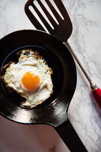 One Sunny Side Up Egg In A Cast Iron Frying Pan
