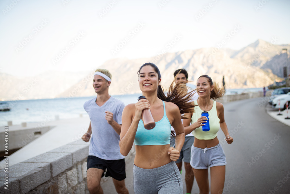 Fototapety, obrazy: Happy people jogging outdoor. Running, sport, exercising and healthy lifestyle concept
