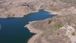 """Aerial view of the """"Las Niñas Dam"""" (East-West Direction with panning) located in the municipality of Tejeda, south of the Canary Island of Gran Canaria (Spain, Europe)."""