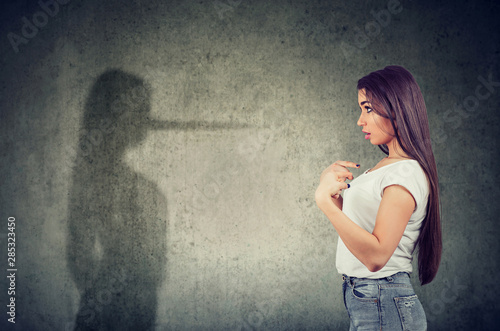 woman pointing at herself looking at a shadow with long nose of a liar Wallpaper Mural