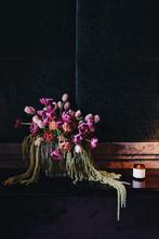 Flowers In A Dark Room