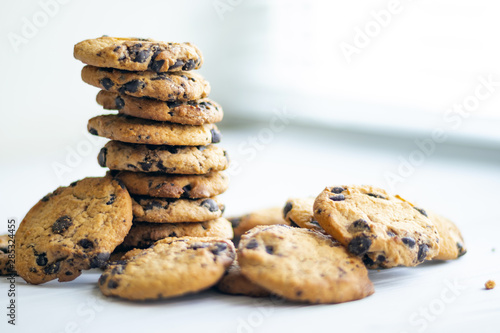 stack of chocolate chip cookies on wooden table Canvas Print