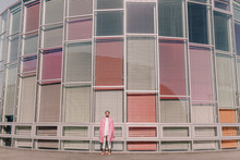 Young Woman Posing In Front Of Modern Building