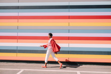 Girl With Colorful Striped Building