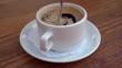 Man Hand Stir Coffee on cafe.