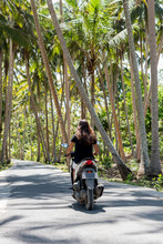 Brunette Woman Riding A Motorbike
