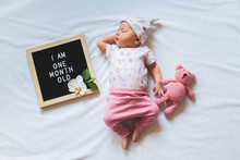 One Month Old Baby Girl Wearin...