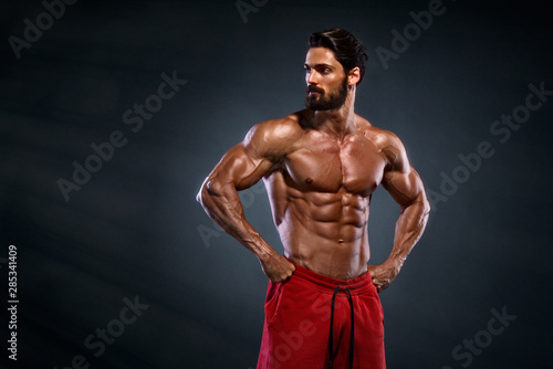 Cuadros en Lienzo Handsome Muscular Men Posing and Flexing Muscles