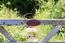 Private Farm Land Fenced Off By A Large Gate, Close Up Of The Private Sign Showing No Access To The Rural Pathway