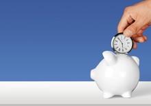 Hand Depositing  Clock  In Pig...