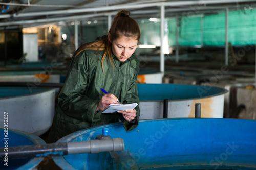 Woman at trout breeding incubator Canvas Print