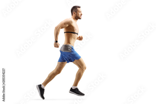 Fotografía Young man running and wearing a chest strap monitor