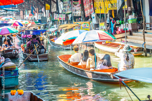 Damnoen Saduak Floating Market, tourists visiting by boat, located in Bangkok, Thailand Wallpaper Mural