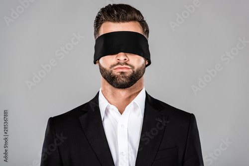 bearded handsome blindfolded businessman in black suit isolated on grey Wallpaper Mural
