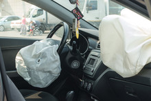 Interior Of Crashed Car After Accident With Deflated Airbags On. Road In City