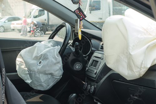 Photo Interior of crashed car after accident with deflated airbags on