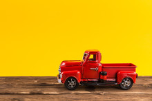Red Toy Truck On Bright Yellow...