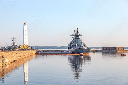 Photo Kronstadt. Wooden lighthouse and moored destroyer