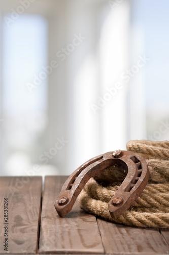 Old horseshoe, lariat lasso and cowboy