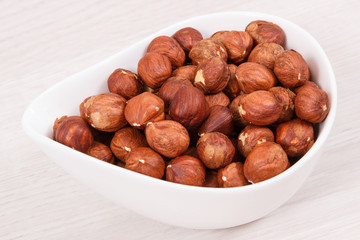 Healthy hazelnuts containing vitamin, minerals and acids, nutritious eating concept
