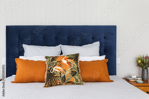 Photo  bedhead dressed cushions interior design