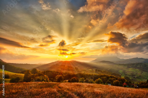 Mountain valley during sunset. Natural autumn landscape
