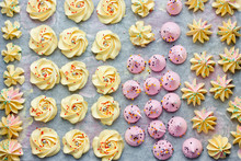 Colorful Meringue Kiss Cookies On Parchment Paper Top View